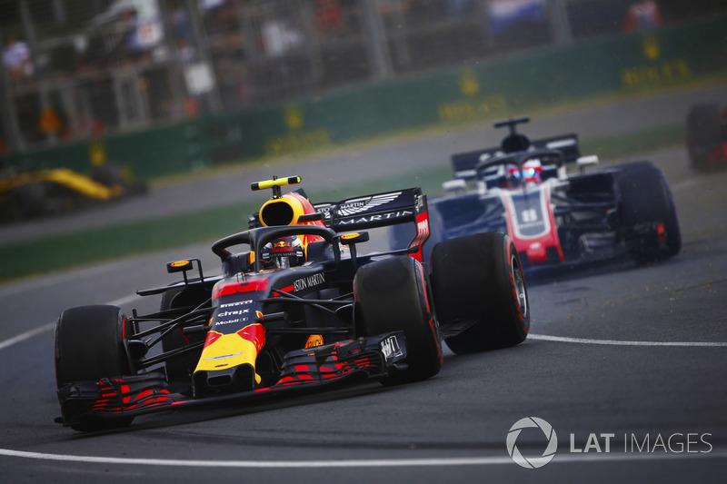 Max Verstappen, Red Bull Racing RB14 Tag Heuer, spins ahead of Romain Grosjean, Haas F1 Team VF-18 Ferrari