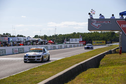 #81 BimmerWorld Racing, BMW 328i, ST: Nick Galante, Devin Jones, Crosses the Finish Line under there checkered flag for the win.