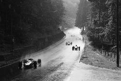Jim Clark, Lotus 33, leads the field in the rain