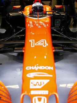 Fernando Alonso, McLaren, in cockpit, in garage, with helmet visor raised