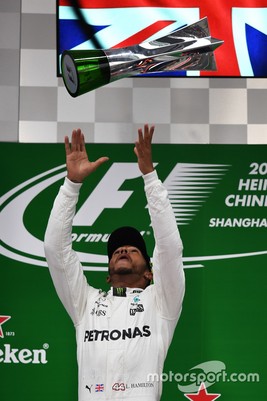 Race winner Lewis Hamilton, Mercedes AMG F1 celebrates on the podium with the trophy