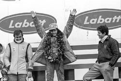 Podium: race winner Gilles Villeneuve, Ferrari, second place Jody Scheckter, Wolf, third place Carlos Reutemann, Ferrari