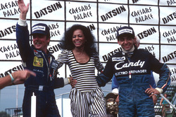 Podium: race winner Michele Alboreto, Tyrell Ford, second place and World Champion Keke Rosberg, Wil
