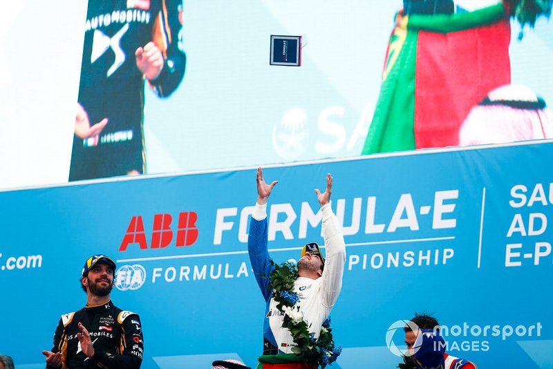 Antonio Felix da Costa, BMW I Andretti Motorsports throws his winner's trophy into the air as Jean-Eric Vergne, DS TECHEETAH watches on