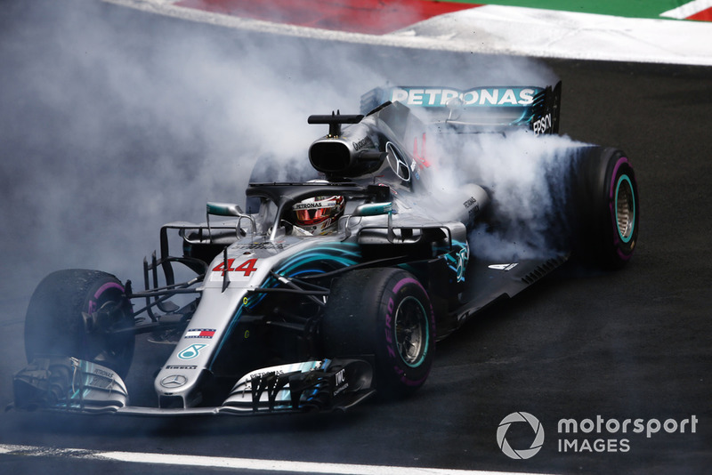 Lewis Hamilton, Mercedes AMG F1 W09 EQ Power+, performs a doughnut as he celebrates winning his fifth World Championship