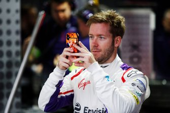 Sam Bird, Envision Virgin Racing takes a photo from inside the garage