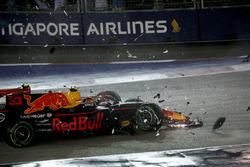 The cars of Kimi Raikkonen, Ferrari SF70H and Max Verstappen, Red Bull Racing RB13 crash and collide