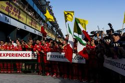 The Ferrari team in Parc Ferme