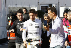 Fernando Alonso, McLaren, at the centre of attention