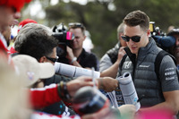 Stoffel Vandoorne, McLaren, signs autographs for fans