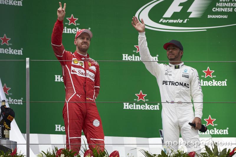Podium: second place Sebastian Vettel, Ferrari, and Race winner Lewis Hamilton, Mercedes AMG, on the podium