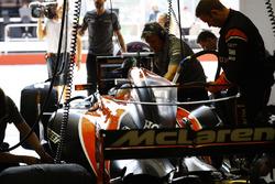 Fernando Alonso, McLaren, prepares to leave his pit garage