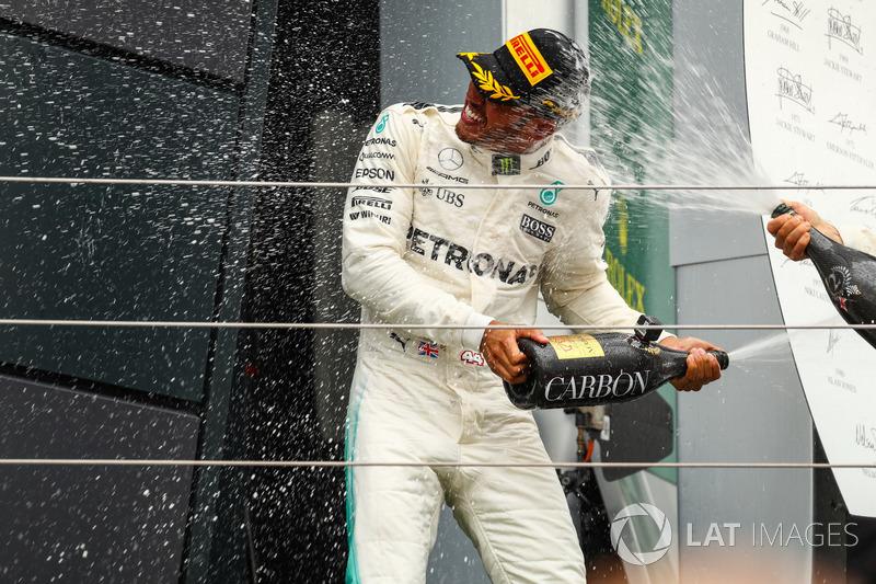 Lewis Hamilton, Mercedes AMG F1 celebrates on the podium, the champagne