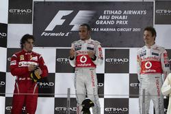 Podium: second place Fernando Alonso, Ferrari, Race winner Lewis Hamilton, McLaren, second place Jenson Button, McLaren