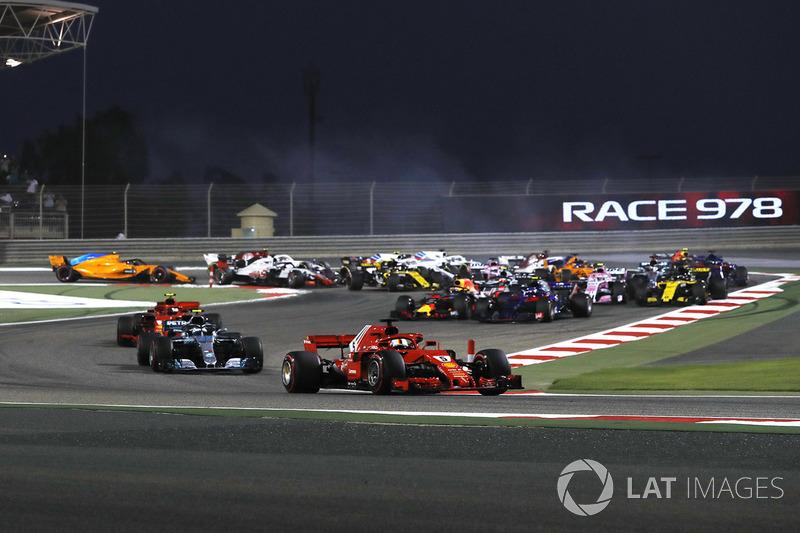 Sebastian Vettel, Ferrari SF-71H leads at the start of the race