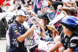 Daniel Ricciardo, Red Bull Racing, signs autographs for fans