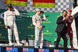Podium: winner Nico Rosberg, Mercedes AMG F1 Team, second place Lewis Hamilton, Mercedes AMG F1 Team, third place Sebastian Vettel, Ferrari with Mark Webber, Porsche Team WEC Driver and Channel 4 Presenter