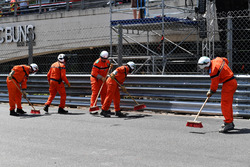 Marshals clean the track after the crash of Max Verstappen, Red Bull Racing RB14