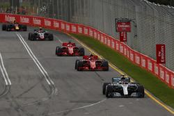 Lewis Hamilton, Mercedes AMG F1 W09, leads Kimi Raikkonen, Ferrari SF71H, Sebastian Vettel, Ferrari SF71H, Kevin Magnussen, Haas F1 Team VF-18 Ferrari, and Max Verstappen, Red Bull Racing RB14 Tag Heuer