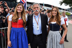 Chase Carey, Chief Executive Officer and Executive Chairman of the Formula One Group and girls