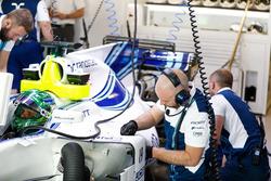 Engineers work on the car of Felipe Massa, Williams FW40