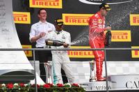 Andy Shovlin, Mercedes AMG F1 Engineer, Lewis Hamilton, Mercedes AMG F1 and Sebastian Vettel, Ferrari celebrate on the podium, the champagne