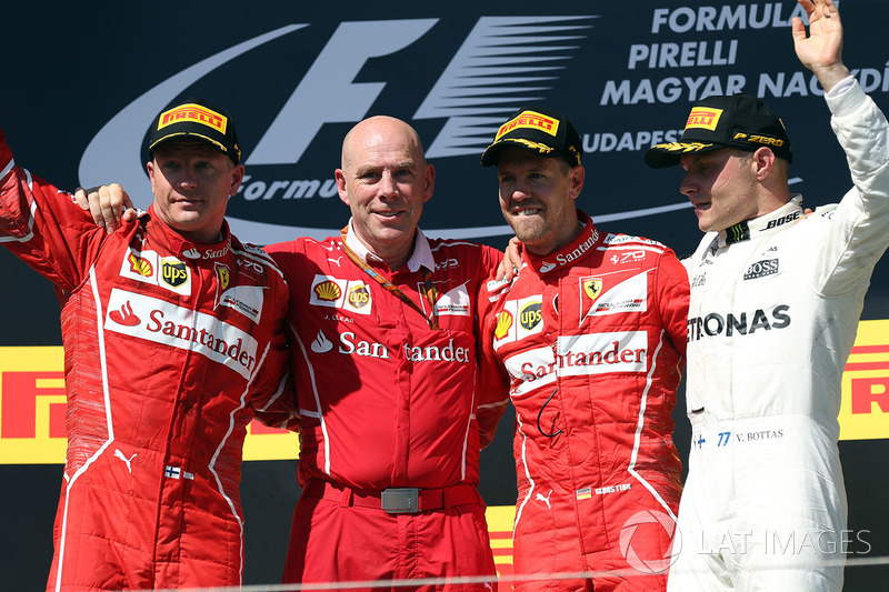 Подіум: переможець гонки Себастьян Феттель, Ferrari, друге місце Кімі Райкконен, Ferrari, третє місце Валттері Боттас, Mercedes AMG F1, Джок Кліер, технічний директор Ferrari