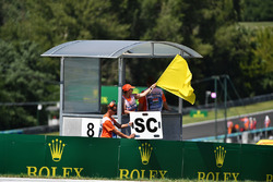 Marshal waves yellow flag and Safety Car board