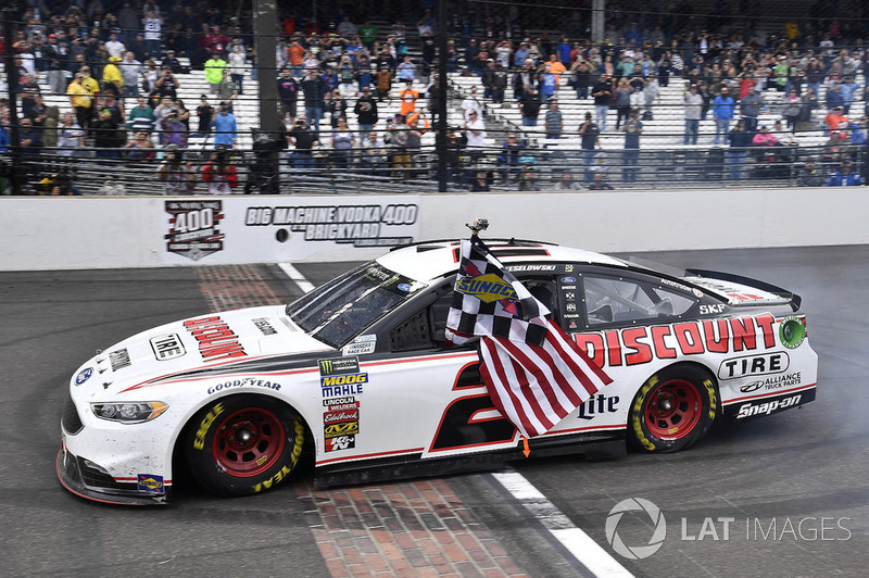 Brad Keselowski, Team Penske, Ford Fusion, celebrates The Captain's first win in the Brickyard 400.