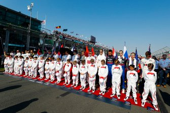 Grid Kids lined up with the drivers for the national anthem