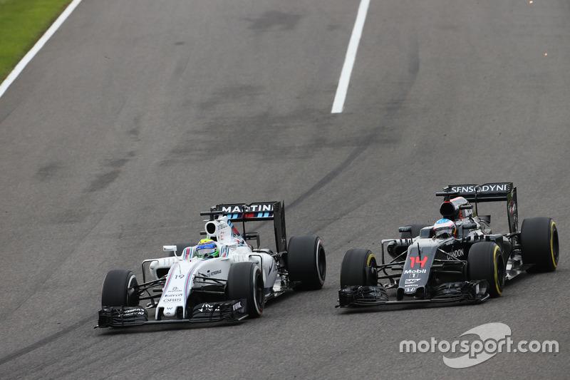 Felipe Massa, Williams FW38 and Fernando Alonso, McLaren MP4-31 battle for position