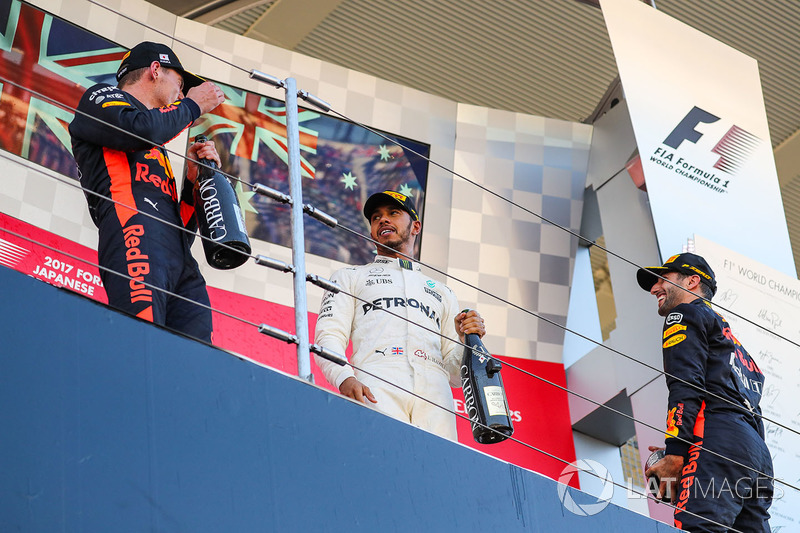 Race winner Lewis Hamilton, Mercedes AMG F1 celebrates on the podium with the champagne alongside Daniel Ricciardo, Red Bull Racing and Max Verstappen, Red Bull Racing