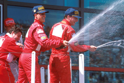 Podium: winner Michael Schumacher, Ferrari, second place Eddie Irvine, Ferrari, third place Mika Hakkinen, McLaren