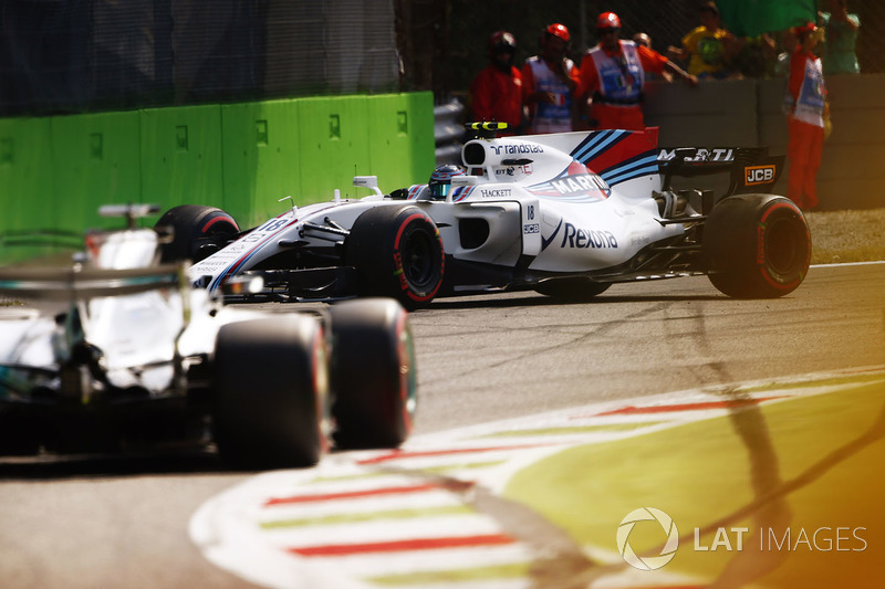 Lewis Hamilton, Mercedes AMG F1 W08, passes a spinning Lance Stroll, Williams FW40
