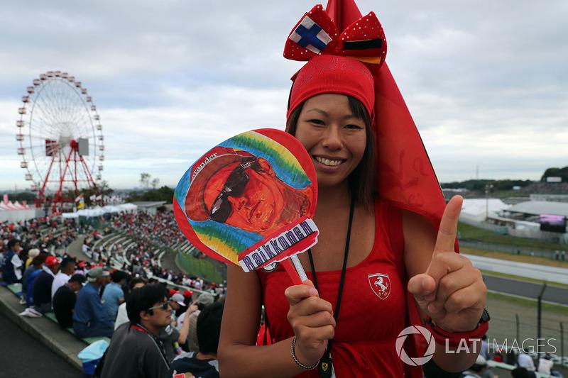 Fan with Kimi Raikkonen, Ferrari banner