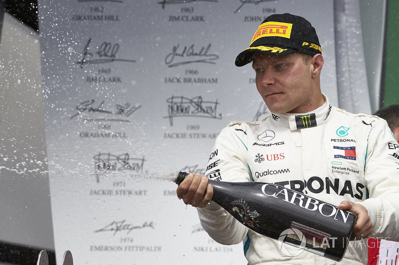 Valtteri Bottas, Mercedes AMG F1, 2nd position, sprays Champagne on the podium