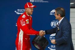 Sebastian Vettel, Ferrari, receives his Pole Position award