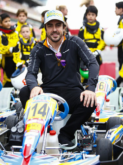 Fernando Alonso, McLaren, poses on a kart