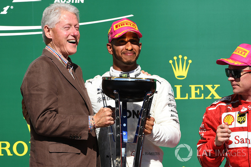 Race winner Lewis Hamilton, Mercedes AMG F1 celebrates on the podium with former US President Bill C