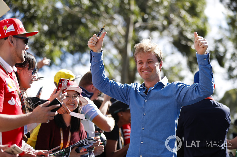 Nico Rosberg signs autographs for fans