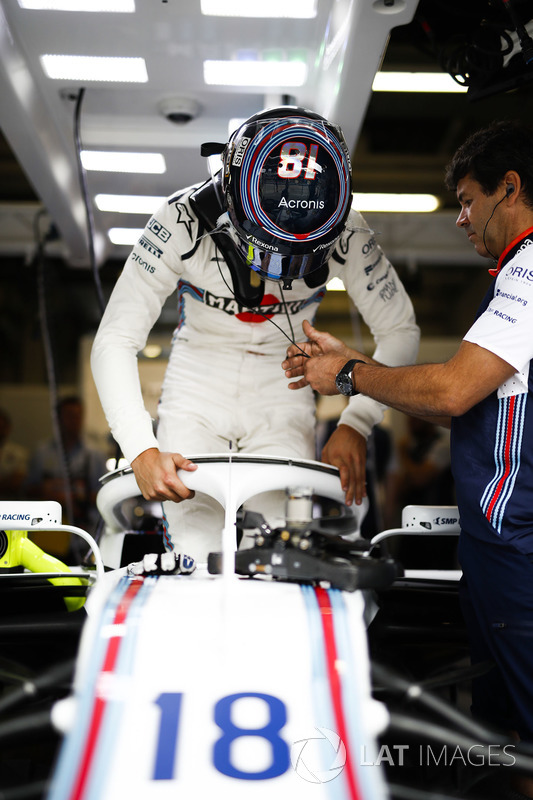 Lance Stroll, Williams Racing, enters his cockpit