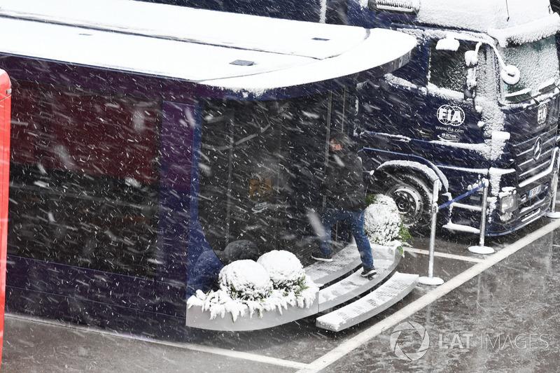 FIA trucks in Paddock as snow stops testing