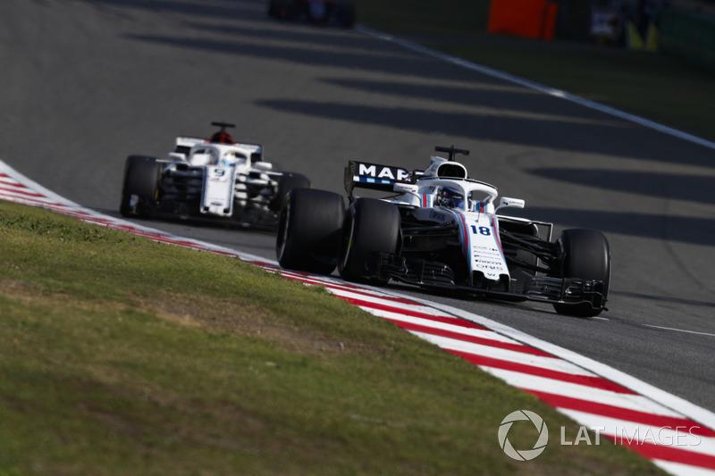 Lance Stroll, Williams FW41 Mercedes, Marcus Ericsson, Sauber C37 Ferrari