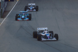 Nigel Mansell, Williams FW16B Renault followed by Michael Schumacher,Benetton B194 Ford and Damon Hill, Williams FW16B Renault