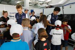 Сергей Сироткин и Лэнс Стролл, Williams, Брендон Хартли, Scuderia Toro Rosso