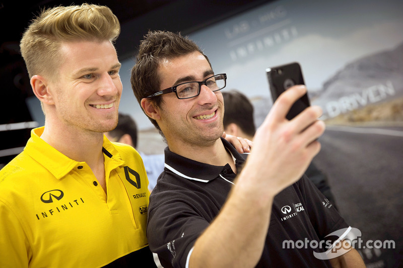 Nico Hulkenberg, Renault Sport F1 Team, with INFINITI Engineering Academy member