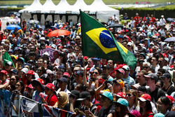 Fans take in the events on the F1 stage