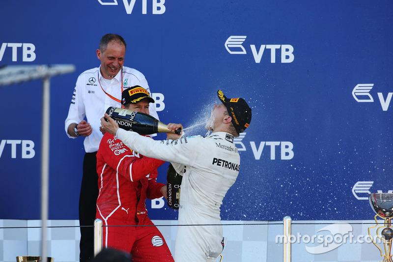 Race winner Valtteri Bottas, Mercedes AMG F1, is sprayed, Champagne by himself and Second place Sebastian Vettel, Ferrari