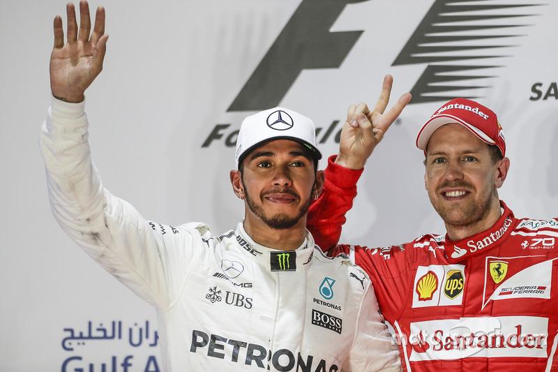 Lewis Hamilton, Mercedes AMG, second place, Sebastian Vettel, Ferrari, race winner, on the podium