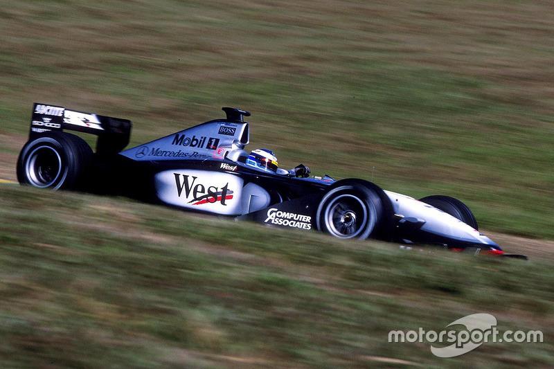 1999. Інтерлагос. Подіум: 1. Mika Hakkinen, McLaren MP4/14 Mercedes. 2. Міхаель Шумахер, Ferrari. 3. Хайнц-Харальд Френтцен, Jordan Mugen Honda